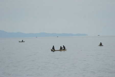 Lake Malawi with dug out canoes