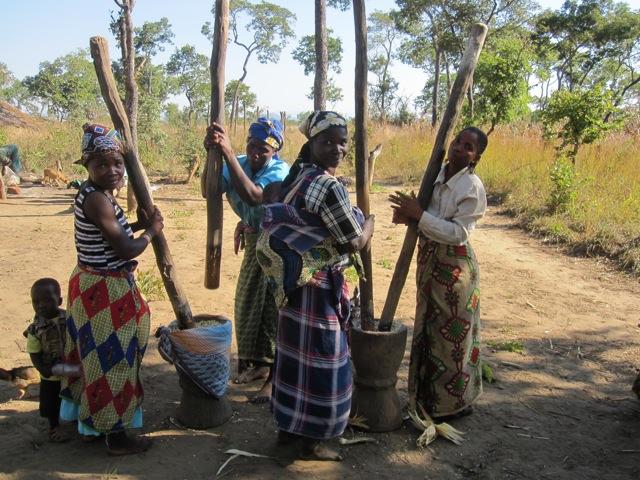 Women grinding maize