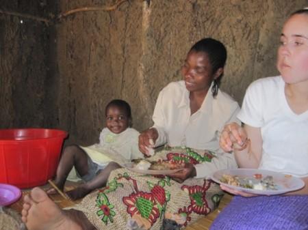 Rachel eating nsima in Moz